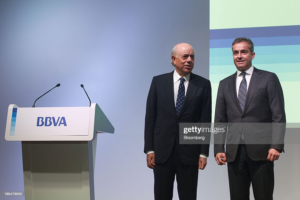Francisco Gonzalez, chairman of Banco Bilbao Vizcaya Argentaria SA (BBVA), left, speaks with Angel Cano, president and chief operating officer of Banco Bilbao Vizcaya Argentaria SA (BBVA), during a news conference to announce the company's fourth-quarter results in Madrid, Spain, on Friday, Feb. 1, 2013. BBVA, Spain's second-biggest bank, posted a 20 million-euro ($27.3 million) fourth-quarter profit as a revenue boost offset costs of completing a cleanup of Spanish real estate assets. Photographer: Angel Navarrete/Bloomberg via Getty Images