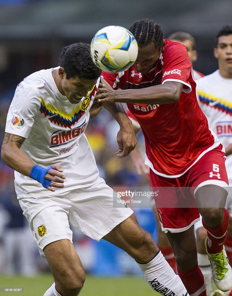 <a gi-track='captionPersonalityLinkClicked' href=/galleries/search?phrase=Francisco+Javier+Rodriguez&family=editorial&specificpeople=469708 ng-click='$event.stopPropagation()'>Francisco Javier Rodriguez</a> of America fights for the ball with Wilson Tiago of Toluca during a Clausura 2013 Liga MX match between America and Toluca at Azteca Stadium on February 16, 2013 in Mexico City, Mexico.