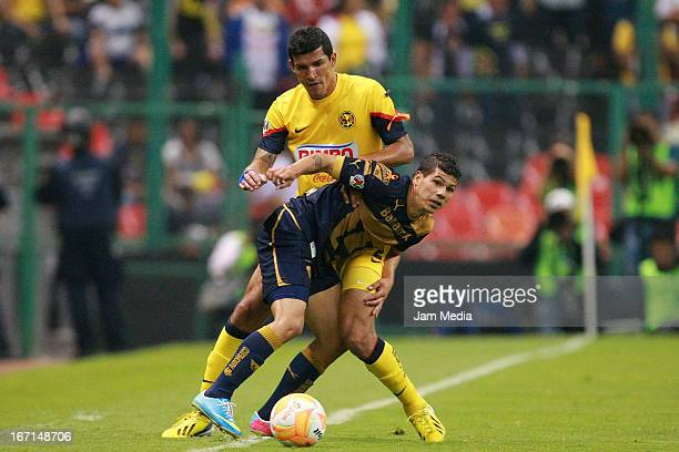 Francisco Javier Rodriguez of America struggles for the ball with Robin Ramirez of Pumas during a match between America and Pumas as part of the...