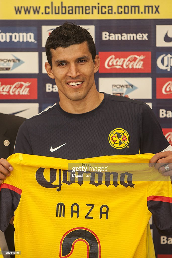 Francisco Javier Rodriguez poses with his shirt during his presentation as a new player of America Futbol Club on January 03, 2012 in Mexico City, Mexico.