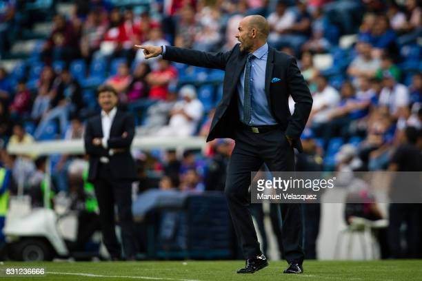 Francisco Jemez coach of Cruz Azul gives isntructions to his players during the 4th round match between Cruz Azul and Chivas as part of the Torneo...