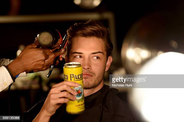 Francisco Lachowski prepares backstage at the 7th Annual amfAR Inspiration Gala at Skylight at Moynihan Station on June 9 2016 in New York City