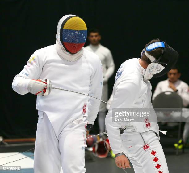 Francisco Limardo of Venezuela makes a touch to the back of MarcAntoine BlaisBelanger of Canada during semifinal action in the Team Men's Epee event...