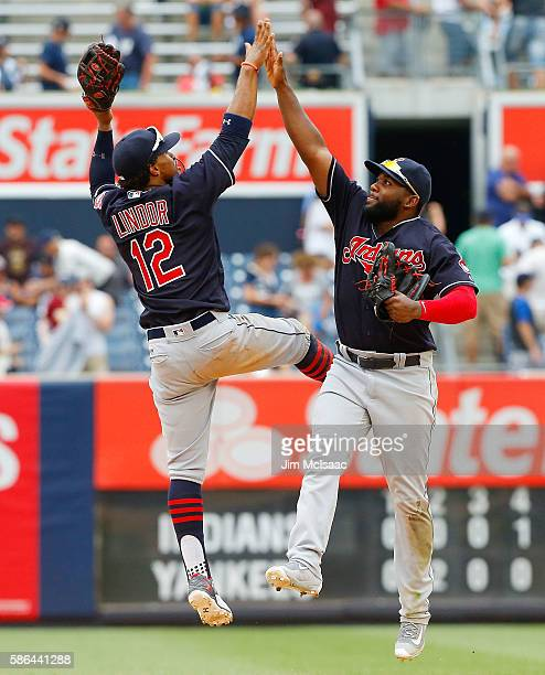 Francisco Lindor and Abraham Almonte of the Cleveland Indians celebrate after defeating the New York Yankees at Yankee Stadium on August 6 2016 in...