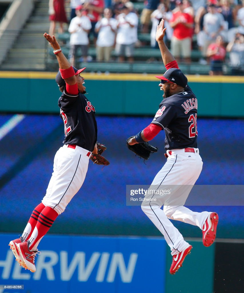 Francisco Lindor #12 and Austin Jackson #26 of the Cleveland Indians celebrate after beating the Kansas City Royals 3-2 at Progressive Field on September 17, 2017 in Cleveland, Ohio.