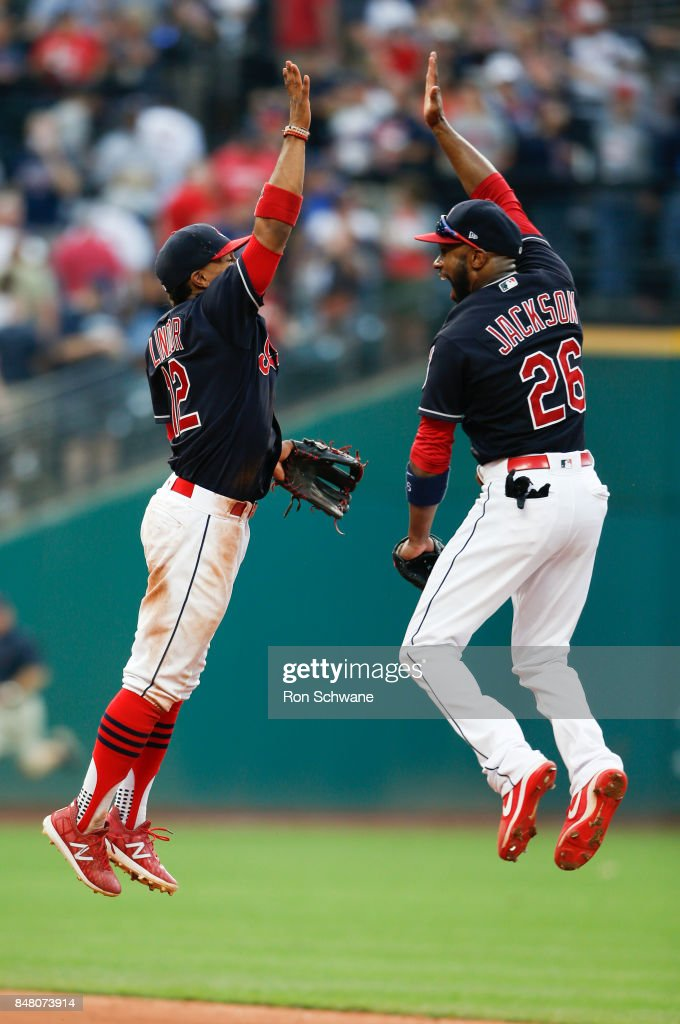 Francisco Lindor #12 and Austin Jackson #26 of the Cleveland Indians celebrate an 8-4 victory over the Kansas City Royals at Progressive Field on September 16, 2017 in Cleveland, Ohio.