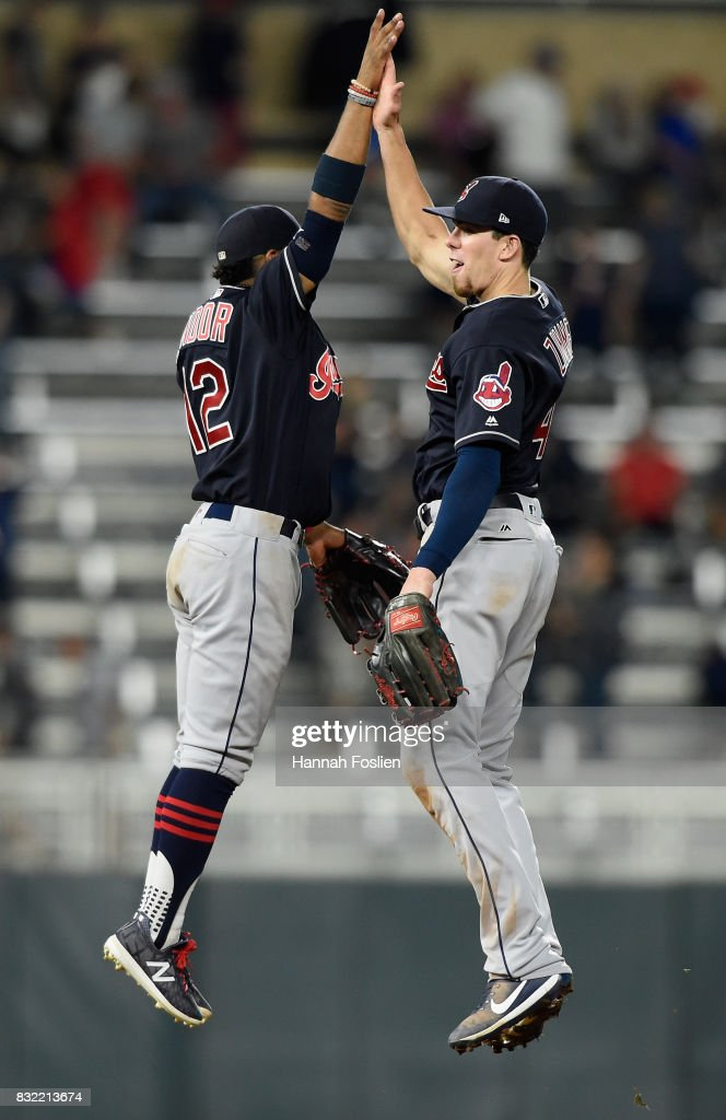 Francisco Lindor #12 and Bradley Zimmer #4 of the Cleveland Indians celebrate winning against the Minnesota Twins after the game on August 15, 2017 at Target Field in Minneapolis, Minnesota. The Indians defeated the Twins 8-1.