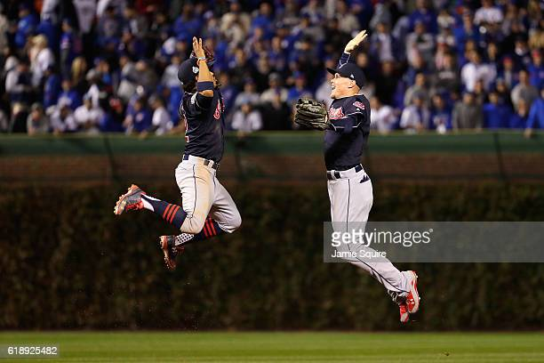 Francisco Lindor and Brandon Guyer of the Cleveland Indians celebrate after defeating the Chicago Cubs 10 in Game Three of the 2016 World Series at...