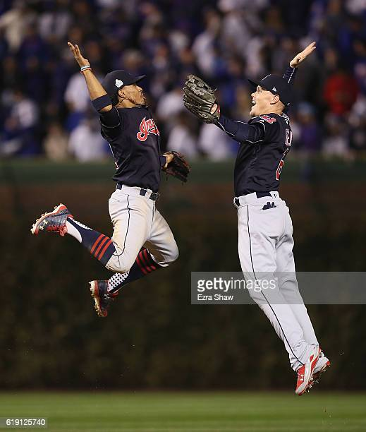 Francisco Lindor and Brandon Guyer of the Cleveland Indians celebrate after beating the Chicago Cubs 72 in Game Four of the 2016 World Series at...