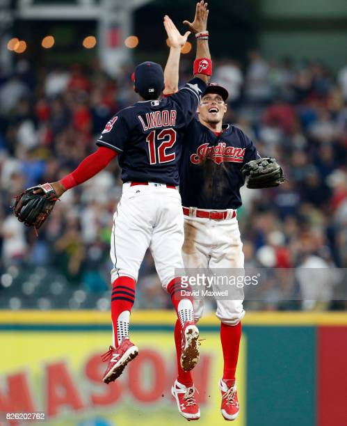 Francisco Lindor and Brandon Guyer of the Cleveland Indians celebrate after defeating the New York Yankees at Progressive Field on August 3 2017 in...