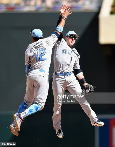 Francisco Lindor and Daniel Robertson of the Cleveland Indians celebrate winning the game against the Minnesota Twins on June 18 2017 at Target Field...