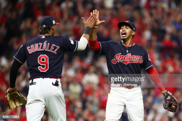 Francisco Lindor and Erik Gonzalez of the Cleveland Indians react after a call was overturned in the eleventh inning against the New York Yankees...