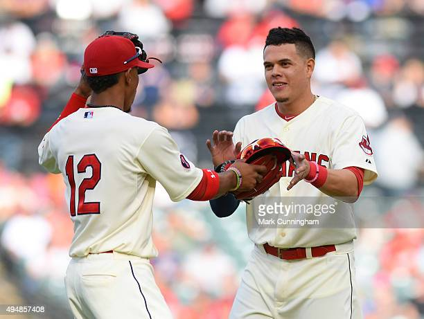 Francisco Lindor and Giovanny Urshela of the Cleveland Indians look on during the game against the Boston Red Sox at Progressive Field on October 4...