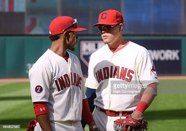 Francisco Lindor and Giovanny Urshela of the Cleveland Indians talk prior to the game against the Boston Red Sox at Progressive Field on October 4...