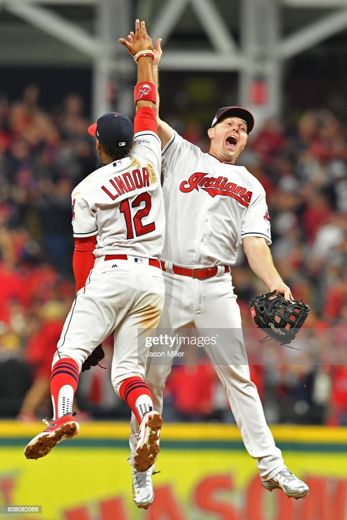 Francisco Lindor #12 and Jay Bruce #32 of the Cleveland Indians celebrate their teams victory over the New York Yankees after game one of the American League Division Series at Progressive Field on October 5, 2017 in Cleveland, Ohio. The Cleveland Indians defeated the New York Yankees 4-0.