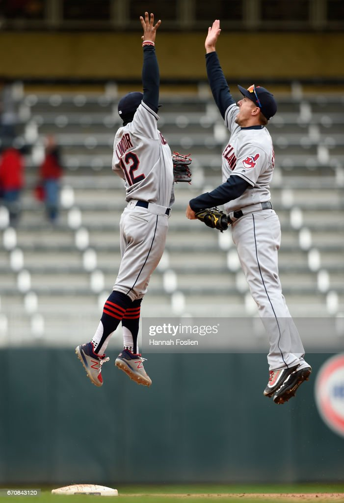 Francisco Lindor #12 and Lonnie Chisenhall #8 of the Cleveland Indians celebrate winning the game against the Minnesota Twins on April 20, 2017 at Target Field in Minneapolis, Minnesota. The Indians defeated the Twins 6-2.