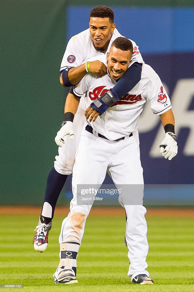 Francisco Lindor #12 and Michael Brantley #23 of the Cleveland Indians celebrate after Brantley hit a walk-off single in the 16th inning against the New York Yankees at Progressive Field on August 12, 2015 in Cleveland, Ohio. The Indians defeated the Yankees 5-4.