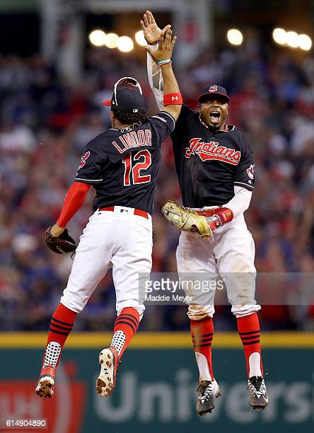 Francisco Lindor and Rajai Davis of the Cleveland Indians celebrate after defeating the Toronto Blue Jays with a score of 2 to 1 in game two of the...
