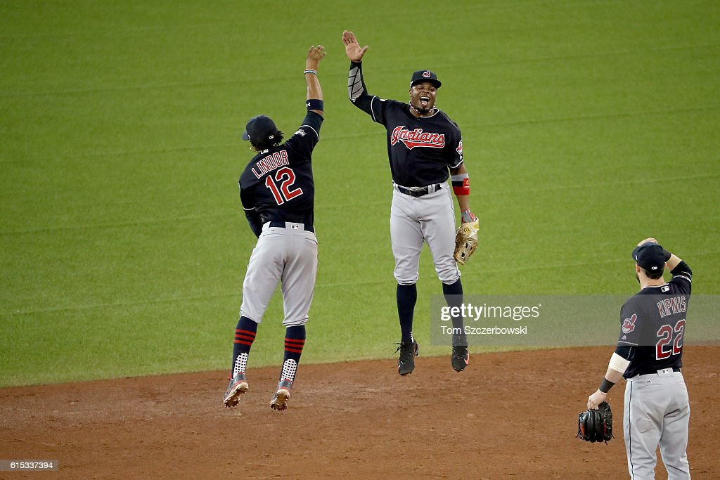Francisco Lindor #12 and Rajai Davis #20 of the Cleveland Indians celebrate after defeating the Toronto Blue Jays with a score of 4 to 2 in game three of the American League Championship Series at Rogers Centre on October 17, 2016 in Toronto, Canada.