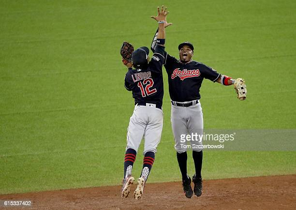 Francisco Lindor and Rajai Davis of the Cleveland Indians celebrate after defeating the Toronto Blue Jays with a score of 4 to 2 in game three of the...