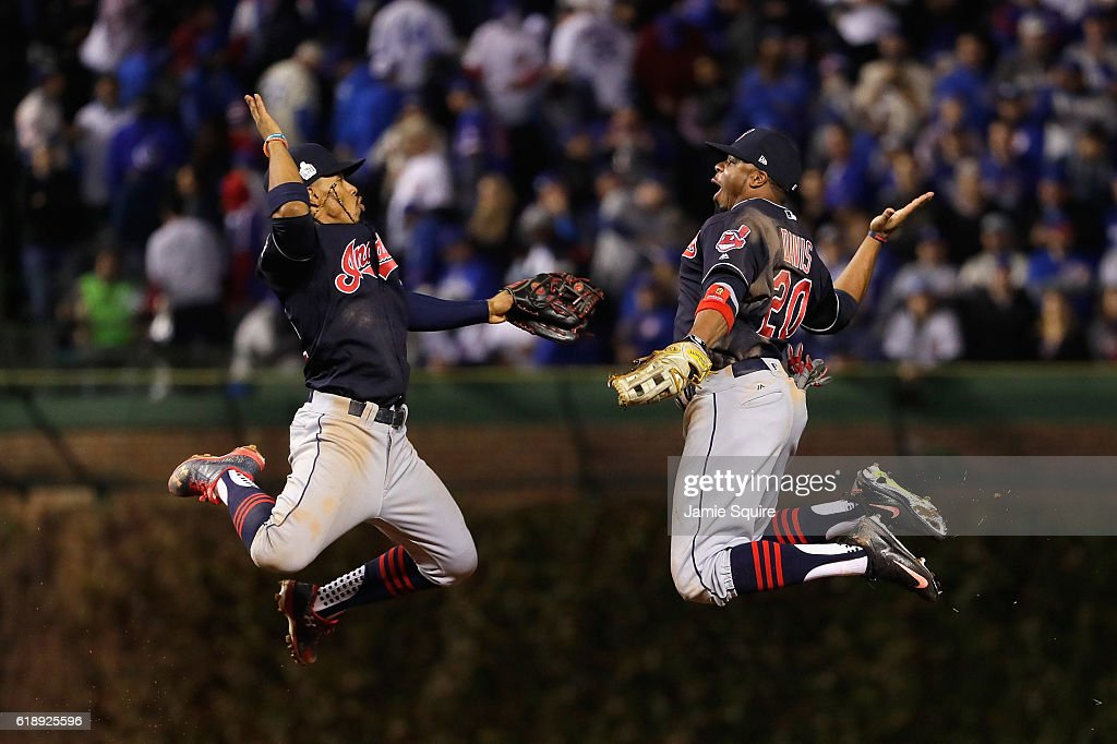 Francisco Lindor #12 and Rajai Davis #20 of the Cleveland Indians celebrate after defeating the Chicago Cubs 1-0 in Game Three of the 2016 World Series at Wrigley Field on October 28, 2016 in Chicago, Illinois.