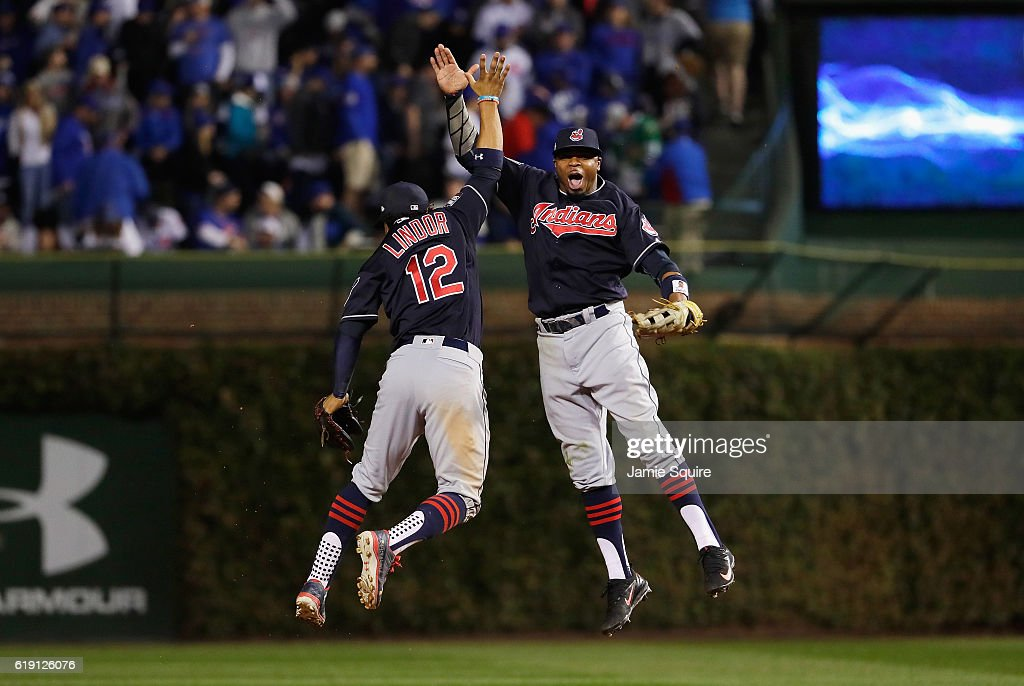 Francisco Lindor #12 and Rajai Davis #20 of the Cleveland Indians celebrate after beating the Chicago Cubs 7-2 in Game Four of the 2016 World Series at Wrigley Field on October 29, 2016 in Chicago, Illinois.
