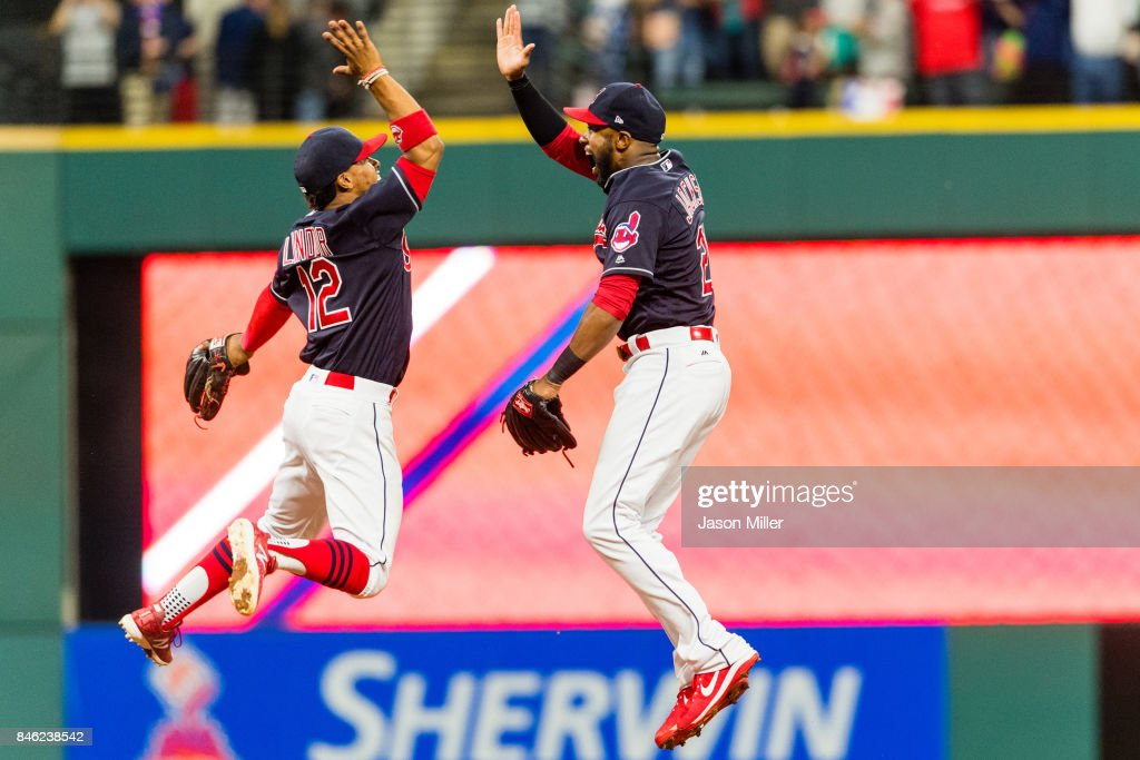 Francisco Lindor #12 celebrates with Austin Jackson #26 of the Cleveland Indians after the Indians defeated the Detroit Tigers at Progressive Field on September 12, 2017 in Cleveland, Ohio. The Indians defeated the Tigers for their 20th straight win.