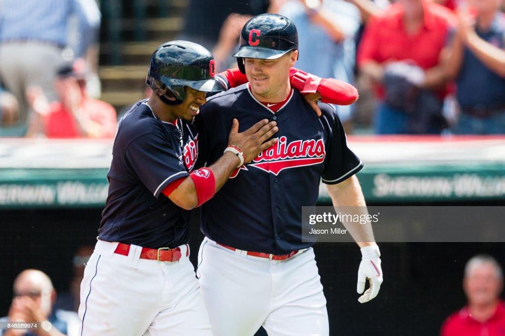 Francisco Lindor #12 celebrates with Jay Bruce #32 of the Cleveland Indians after both scored during the first inning on a home run by Bruce at Progressive Field on September 13, 2017 in Cleveland, Ohio.