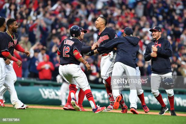 Francisco Lindor celebrates with Michael Brantley of the Cleveland Indians and other teammates after the two combined for a walkoff win over the...