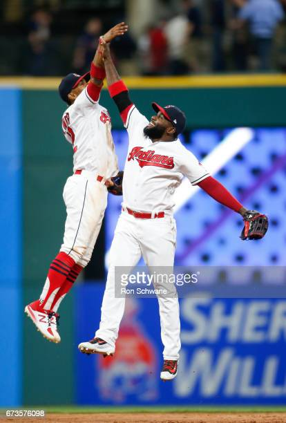 Francisco Lindor of the Cleveland Indians and Abraham Almonte celebrate a 76 victory against the Houston Astros at Progressive Field on April 26 2017...
