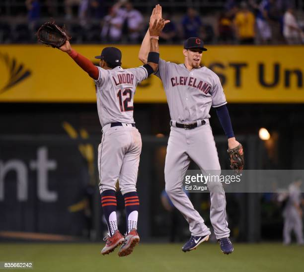 Francisco Lindor of the Cleveland Indians and Bradley Zimmer celebrate a 50 win over the Kansas City Royals at Kauffman Stadium on August 19 2017 in...