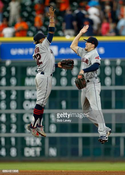 Francisco Lindor of the Cleveland Indians and Bradley Zimmer high five after beating the Houston Astros at Minute Maid Park on May 21 2017 in Houston...