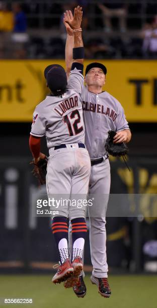 Francisco Lindor of the Cleveland Indians and Jay Bruce celebrate a 50 win over the Kansas City Royals at Kauffman Stadium on August 19 2017 in...