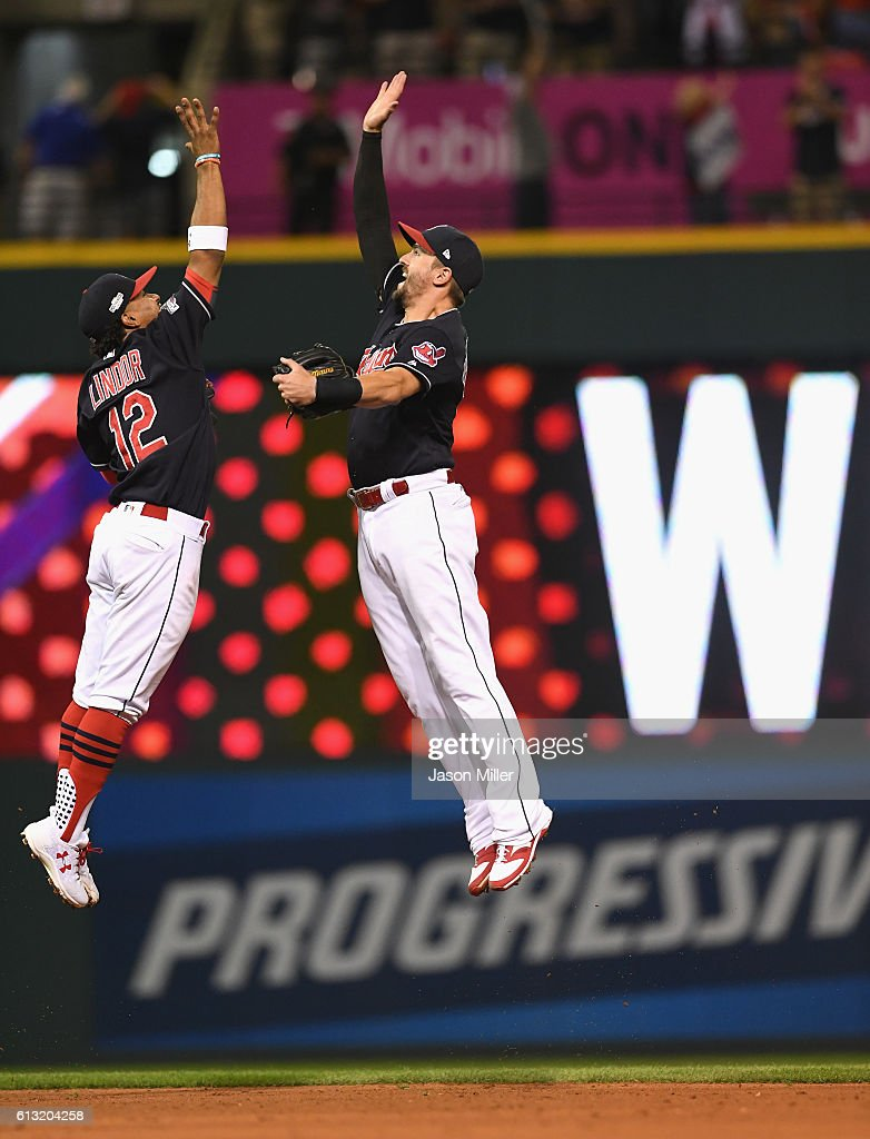 Francisco Lindor #12 of the Cleveland Indians and Lonnie Chisenhall #8 celebrate after defeating the Boston Red Sox 6-0 in game two of the American League Divison Series at Progressive Field on October 7, 2016 in Cleveland, Ohio.