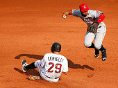 Francisco Lindor of the Cleveland Indians attempts to turn the double play over Francisco Cervelli of the Pittsburgh Pirates during the interleague...