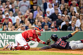 Francisco Lindor of the Cleveland Indians avoids the tag of Christian Vazquez of the Boston Red Sox as he scores during the third inning of a game on...