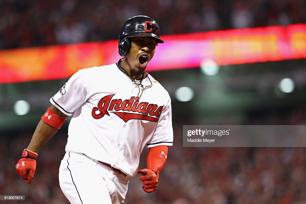Francisco Lindor of the Cleveland Indians celebrates as he runs the bases after hitting a solo home run in the third inning against the Boston Red...