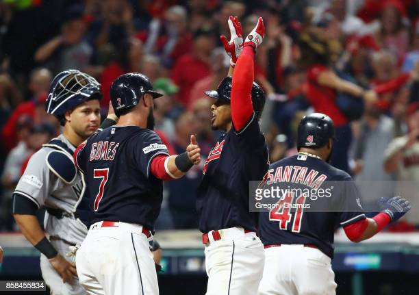 Francisco Lindor of the Cleveland Indians celebrates his grand slam with Yan Gomes in the sixth inning during game two of the American League...
