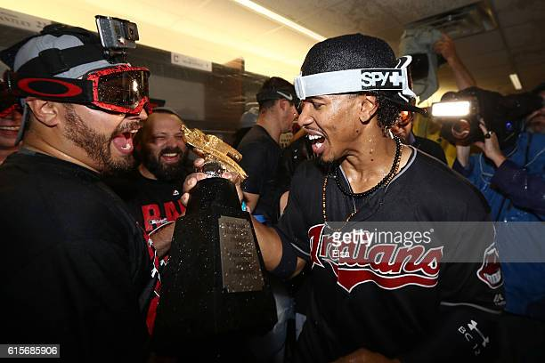 Francisco Lindor of the Cleveland Indians celebrates with his teammates and the William Harridge Award in the locker room after defeating the Toronto...