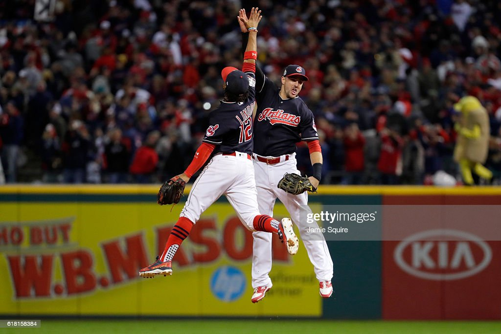 Francisco Lindor #12 of the Cleveland Indians celebrates with Lonnie Chisenhall #8 after defeating the Chicago Cubs 6-0 in Game One of the 2016 World Series at Progressive Field on October 25, 2016 in Cleveland, Ohio.