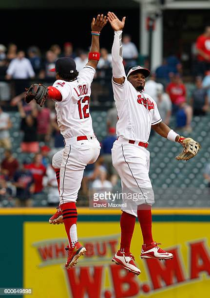 Francisco Lindor of the Cleveland Indians celebrates with Rajai Davis after defeating the Houston Astros at Progressive Field on September 8 2016 in...