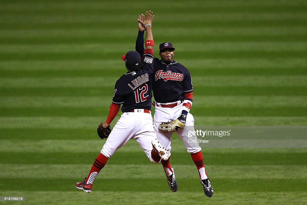 Francisco Lindor #12 of the Cleveland Indians celebrates with Rajai Davis #20 after defeating the Chicago Cubs 6-0 in Game One of the 2016 World Series at Progressive Field on October 25, 2016 in Cleveland, Ohio.