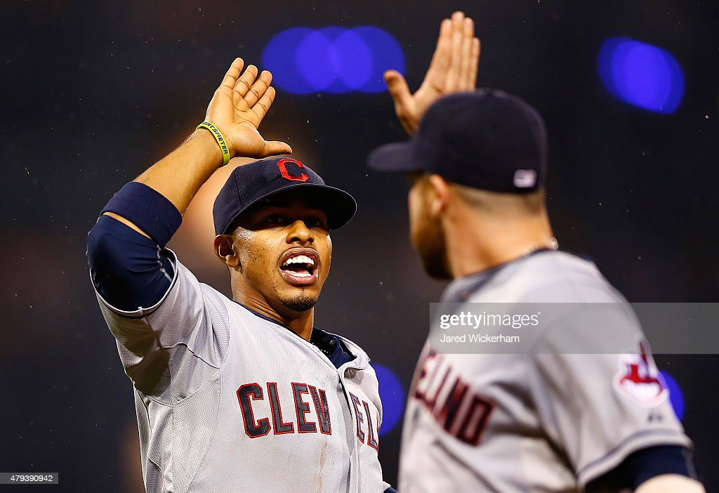 <a gi-track='captionPersonalityLinkClicked' href=/galleries/search?phrase=Francisco+Lindor&family=editorial&specificpeople=8126906 ng-click='$event.stopPropagation()'>Francisco Lindor</a> #12 of the Cleveland Indians celebrates with teammate <a gi-track='captionPersonalityLinkClicked' href=/galleries/search?phrase=Jason+Kipnis&family=editorial&specificpeople=5330784 ng-click='$event.stopPropagation()'>Jason Kipnis</a> #22 after turning the inning-ending double play in the sixth inning against the Pittsburgh Pirates during the interleague game at PNC Park on July 3, 2015 in Pittsburgh, Pennsylvania.