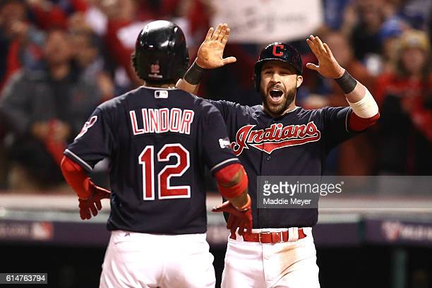 Francisco Lindor of the Cleveland Indians celebrates with teammate Jason Kipnis after hitting a two run home run to right field against Marco Estrada...
