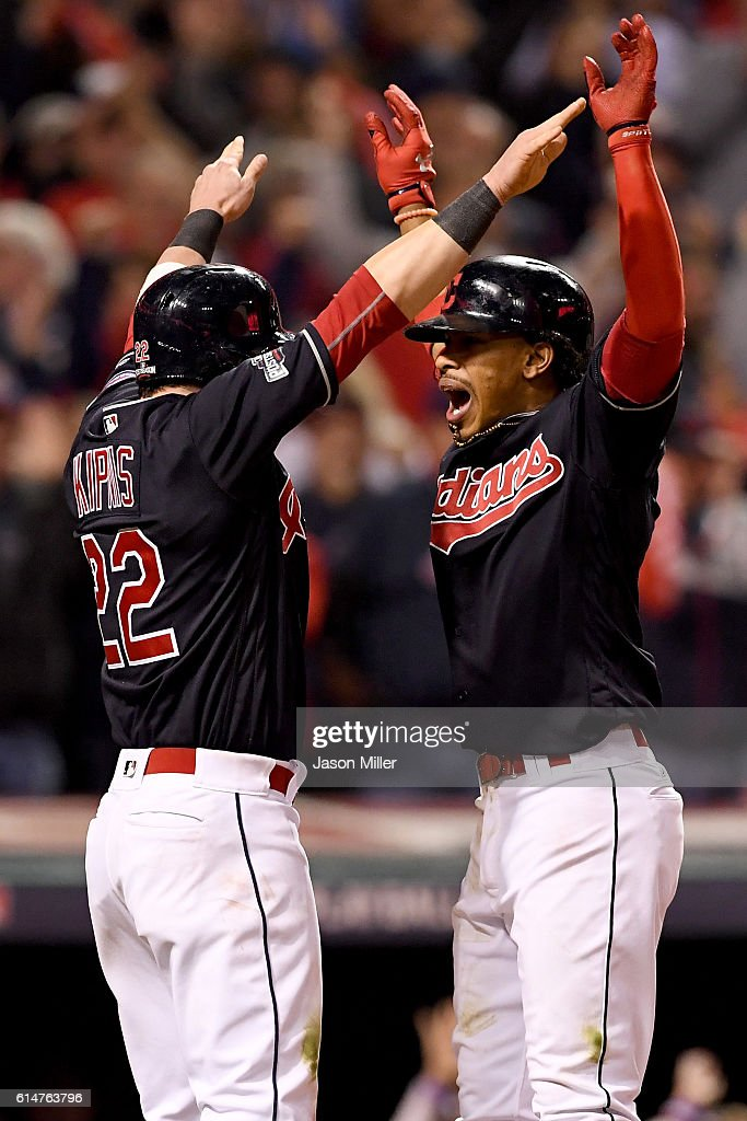 Francisco Lindor #12 of the Cleveland Indians celebrates with teammate Jason Kipnis #22 after hitting a two run home run to right field against Marco Estrada #25 of the Toronto Blue Jays in the sixth inning during game one of the American League Championship Series at Progressive Field on October 14, 2016 in Cleveland, Ohio.