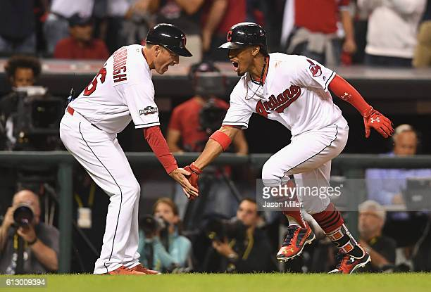 Francisco Lindor of the Cleveland Indians celebrates with third base coach Mike Sarbaugh after hitting a solo home run in the third inning against...