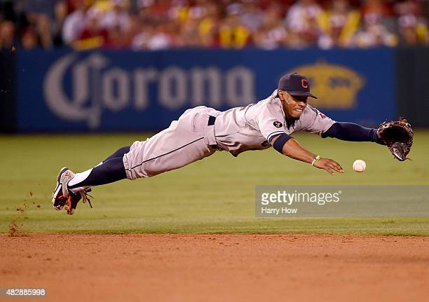 Francisco Lindor of the Cleveland Indians dives for a ball off the bat of Mike Trout of the Los Angeles Angels during the sixth inning at Angel...
