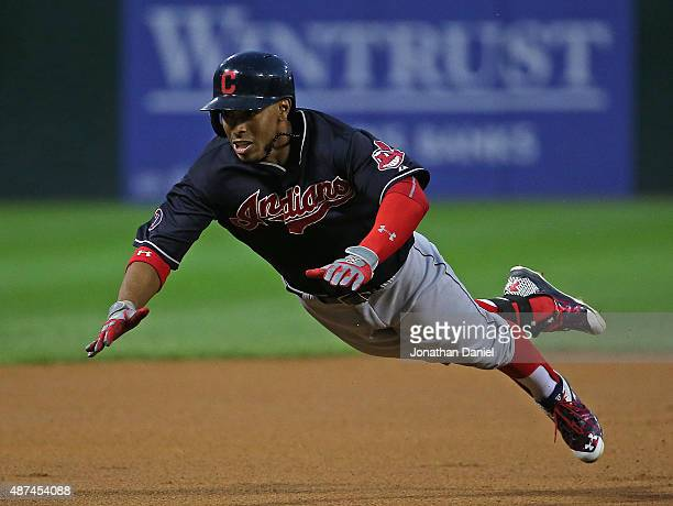 Francisco Lindor of the Cleveland Indians dives into third base with a triple in the 1st inning against the Chicago White Sox at US Cellular Field on...