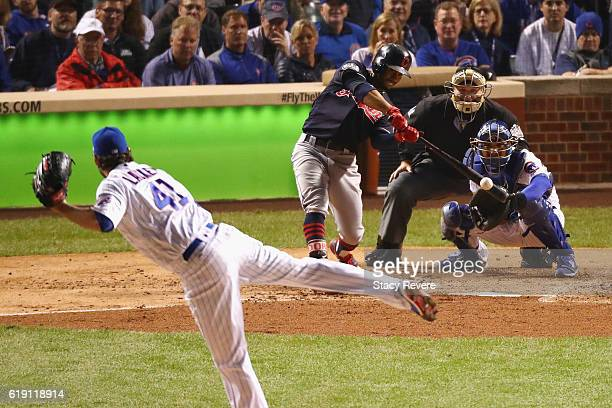 Francisco Lindor of the Cleveland Indians hits a single off of John Lackey of the Chicago Cubs in the third inning in Game Four of the 2016 World...