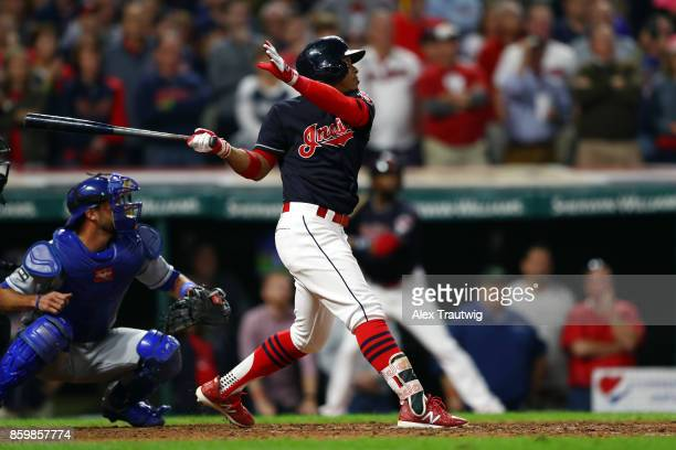 Francisco Lindor of the Cleveland Indians hits an RBI double in the bottom of the ninth inning during the game against the Kansas City Royals at...